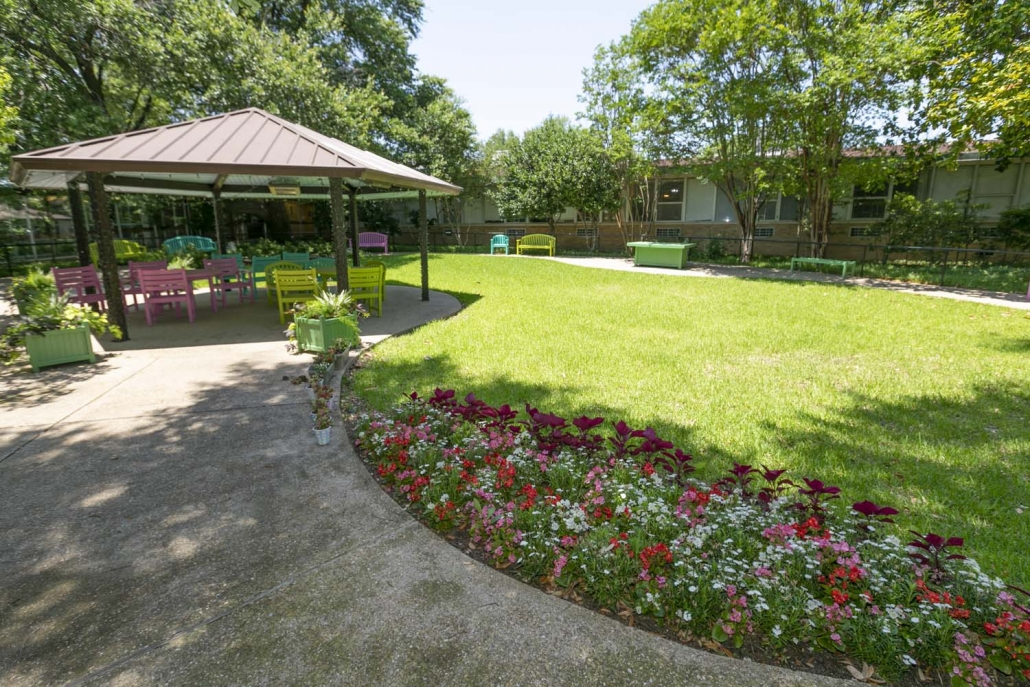 A photo of one of the outdoor sitting areas at The Villages of Dallas.